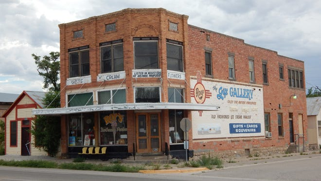 Despite its disuse, Roy's Gift Gallery, formerly Paden's Drug Store, is on the National Register of Historic Places and remains a reminder of past events, as well as an example of a distinctive type of building.
