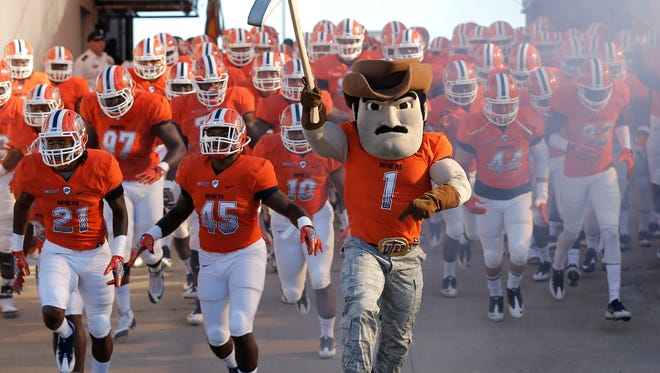 Paydirt Pete leads the Miners onto the field to face Army at the Sun Bowl Stadium in 2016.