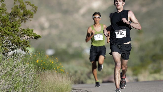 Nathan Richards, foreground, led the first part of the McKelligon Canyon Challenge 5K but later was passed by Michael Abeyta, background. Abeyta and Richards finished first and second, respectively.