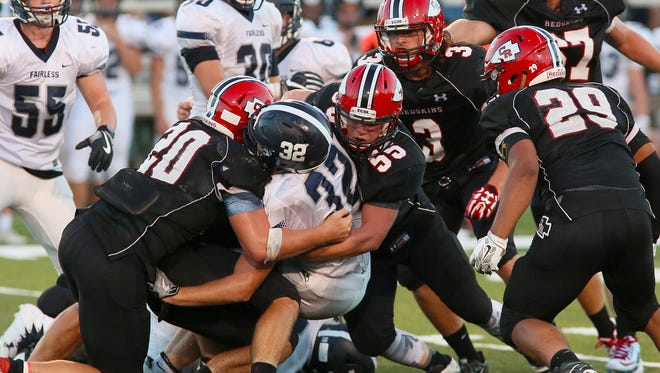 The Coshocton defense clamps down on Navarre Fairless in the season opener.