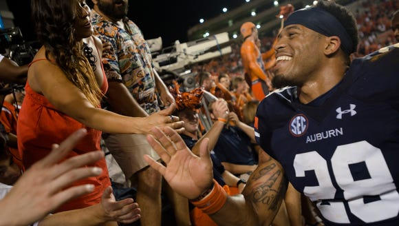 Auburn defensive back Tray Matthews (28) celebrates