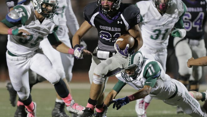 Franklin running back Seth Dominguez breaks into the open field Friday against Montwood.