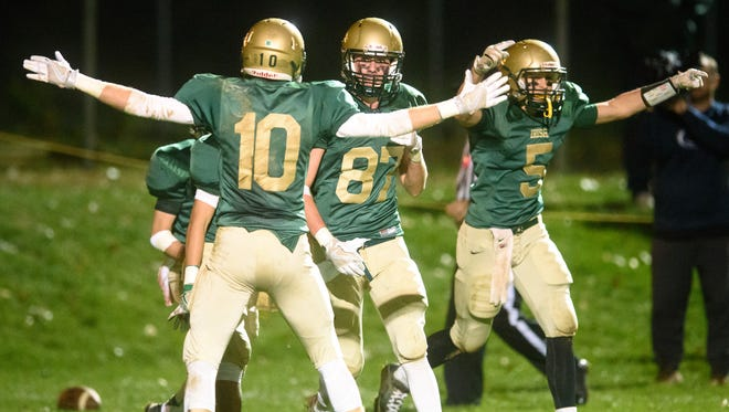 York Catholic's Riley Brennan (87) celebrates a touchdown with teammates against Bermudian Springs in a YAIAA football game on Friday, Oct. 21, 2016. York Catholic won 35-7.