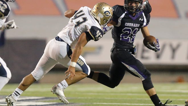 Franklin running back Seth Dominquez is chased throught the backfield by Coronado tackle John Heredia last year at the Sun Bowl.