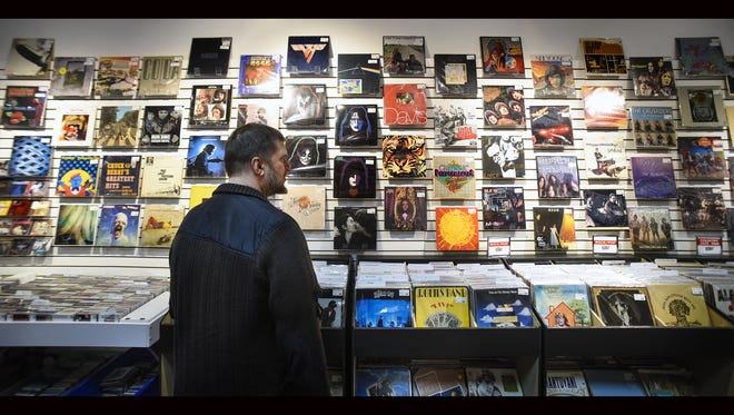Music specialist Jeff Pederson talks about the in-store selection of new and used vinyl Thursday, Nov. 3, at Fan HQ Rock N Jock inside Crossroads Center in St. Cloud