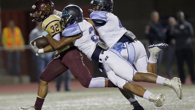 Andress running back Dorian Lewis is caught far down field by Chapin defensive backs Christian McKeever and Kevin Licon.