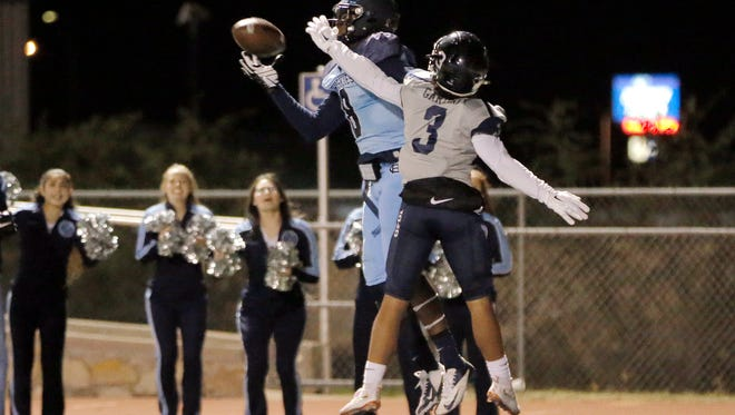 Chapin wide receiver Ryan Wilson makes a one-handed catch in the endzone over Del Valle's Karch Gardiner in the second half of their bi-district game Thursday at Conquest Stadium.