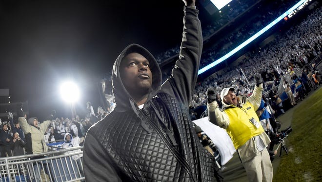 Penn State alumni LaVar Arrington joins the crowd in celebrating a second half TD during PSU's defeat of Michigan State 45-12 to win the Big 10 East Championship in State College on Saturday, Nov. 26, 2016.
