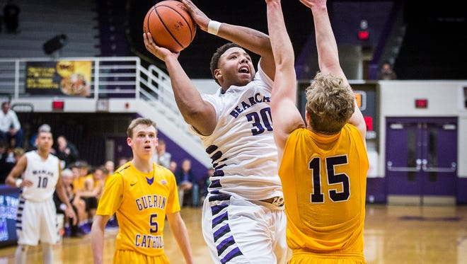 Central's Jajuan Wells shoots past Guerin Catholic's defense during their game at the Muncie Fieldhouse Saturday, Dec. 10, 2016.