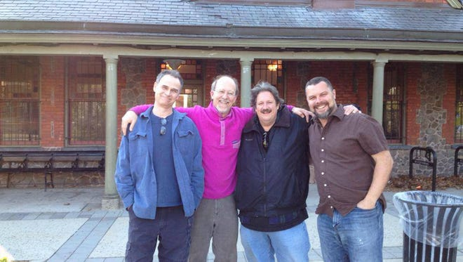 Four members of the 100th Monkey Foundation gather outside the Glen Ridge Train Station in this 2015 file photo. From left: James Harr, Doug Gillespie, James Collins and Jim Cowan.