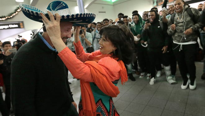 North Carolina head football coach Larry Fedora is given a sombrero to where during the team's El Paso-style welcome Sunday evening at the El Paso International Airport.