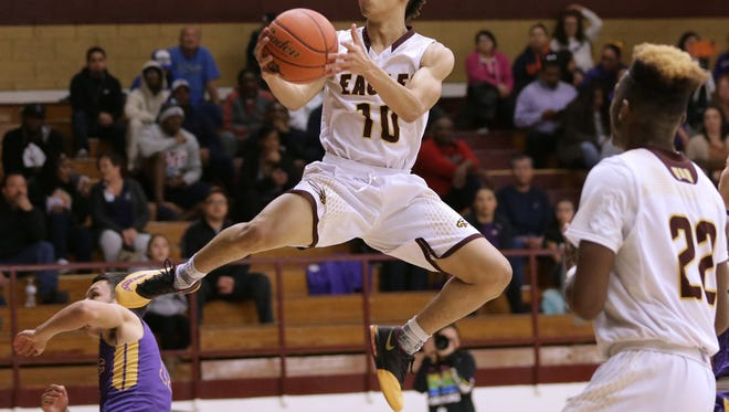 Andress guard Eric Simmons flies to the hoop against Burges Tuesday at Andress High School. Andress defeated Burges 63-58.