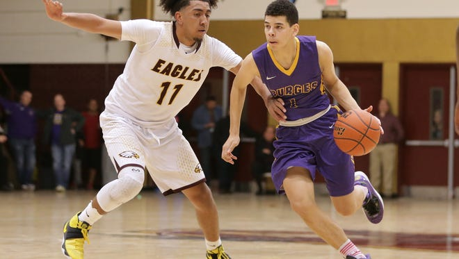 Burges guard Deion Bauman, right was named to the Class 5A All-State boys basketball team by the TABC.