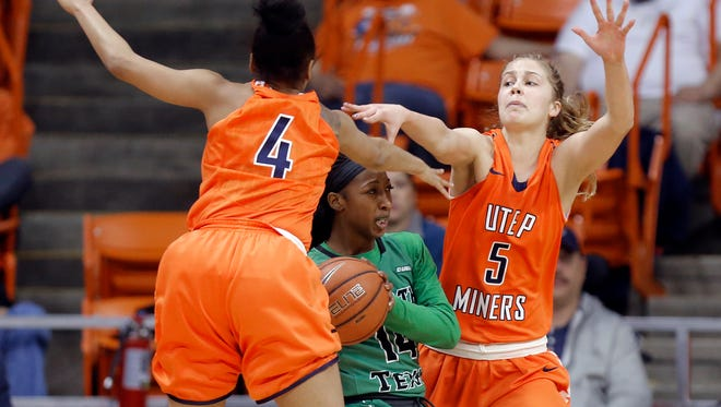 UTEP's Lulu McKinney, left, and Zuzanna Puc, right, smother North Texas guard Candice Adams in the first half of their game at the Don Haskins Center.