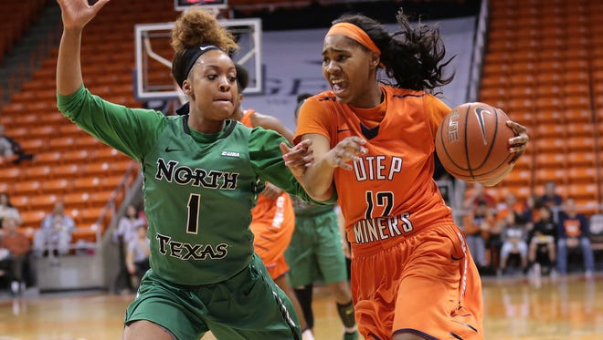 UTEP's Sparkle Taylor tries to overtake UNT's Tyara Warren on her way to the hoop.