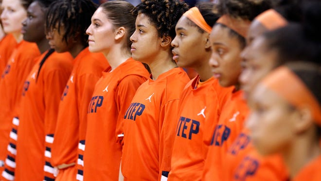 The Miners change up their routine during the National Anthem Thursday lining up side-by-side on the court rather than front to back along the bench.