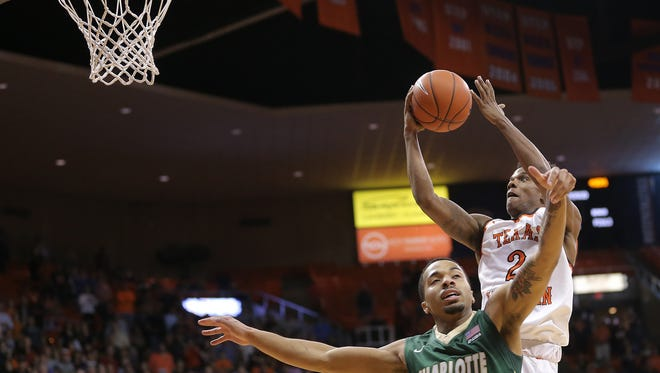 UTEP's Omega Harris shoots over Charlotte's Jon Davis on Saturday at the Don Haskins Center.