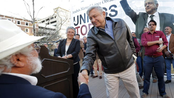 Mexican presidential hopeful Andrés Manuel López Obrador of the Morena party greets audience members before speaking at San Jacinto Plaza in El Paso Monday.