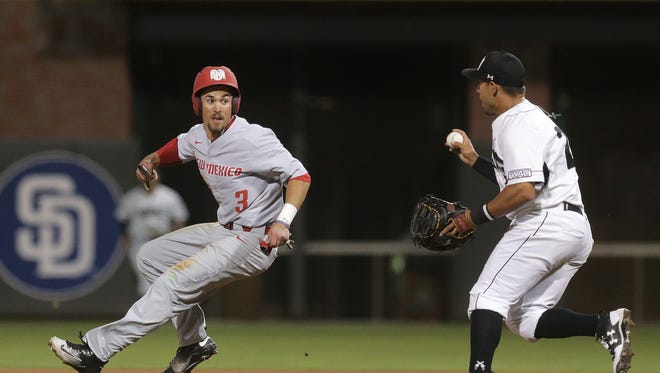 New Mexico baserunner Hayden Schilling is caught in a pickle between first and second before being tagged out by NMSU first baseman Tristen Carranza.