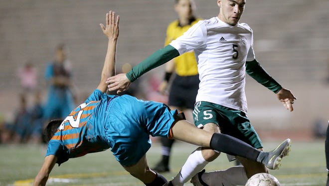 Montwood's Jose Lara shrugs off Pebble Hills defender Daniel Belmontes during their game Friday night at the SAC.
