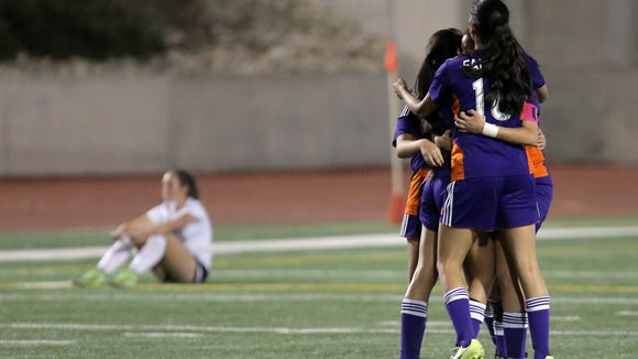 Eastlake celebrates their 1-0 win over Hanks to remain alive in District 2-5A.