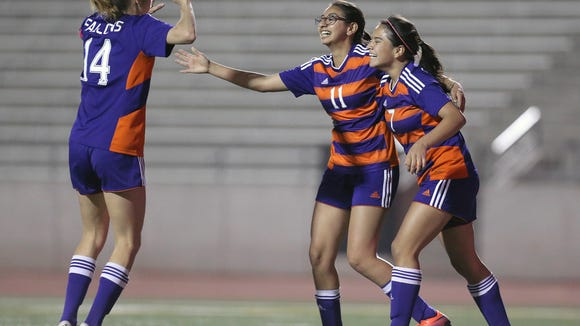 Eastlake's Andrea Griego, center, celebrates her team's only goal of the evening Monday against Hanks.