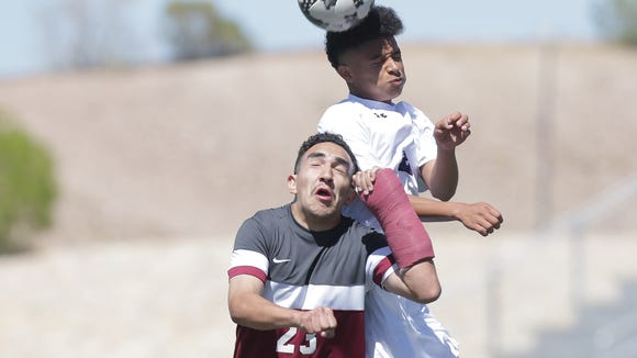 Franklin's Quinton Brown beats Midland Lee's Jeremias Carrasco to a header during their playoff match last month.