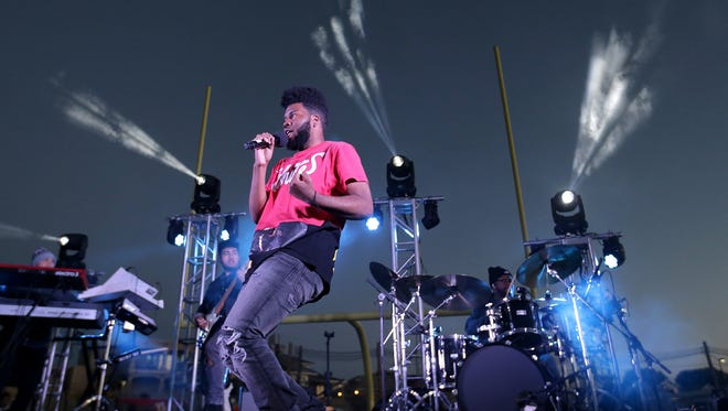 Khalid wooed El Pasoans with his smooth delivery during an invite-only concert in front of an intimate crowd of 300 at the Americas High School football field.