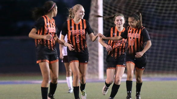 El Paso High's Isabella Benavides (8) celebrates her first-half goal with teammates in their 5A regional quarterfinal Tuesday at Irvin.