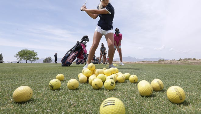 UTEP's Lily Downs hits balls on the driving range Thurday as the team prepares for the Conference tournament.