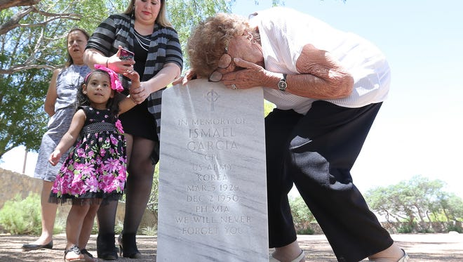 Virginia Mendez grieves on her brother Ismael Garcia's grave marker at the Fort Bliss National Cemetery following a memorial service for the U.S. Army Corporal who went Missing in Action on December, 2, 1950 while fighing in the Korean War. Garcia's family held a memorial service Friday at the cemetery to officially say goodbye to Garcia.