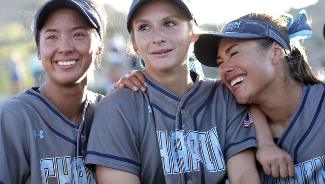 Chapin catcher Kristin Fifield, center celebrates with teammates after pitching her second consecutive complete game against Eastlake. Chapin defeated Eastlake 9-8 to win the 5A Regional Quarterfinal.