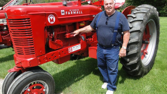 Karl Kayzar has been collecting tractors since 1992 when he bought his favorite, the Super M, that reminded him of the one he frequently drove in his youth.  In fact, he doesn't know for sure but there is evidence that it might just be the very tractor he drove.