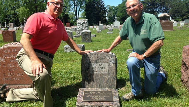 Dean Herbst (left), a family service counselor at Lincoln Memorial Cemetery, and Bob Giese of Historic Milwaukee pose with the new grave marker for Emil Seidel, Milwaukee's first Socialist mayor who died in 1947. Seidel's ashes were buried in the grave of his ex-wife, Lucy Geissel.