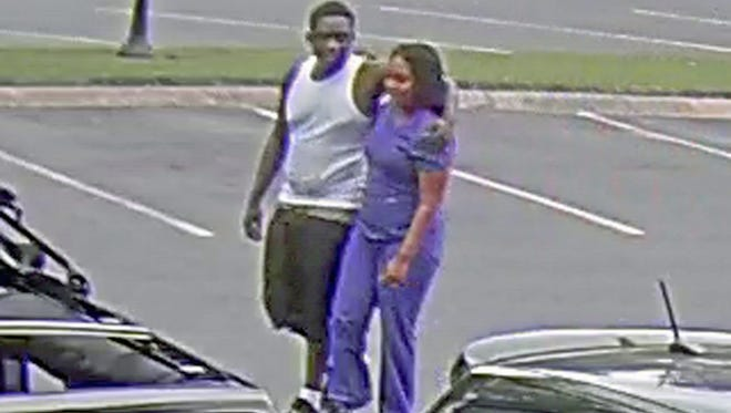 Metro police are searching for suspects, pictured here, who stole money and jewelry from a parked car last month.