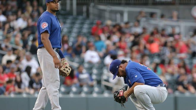 Iowa pitcher Williams Perez tries to shake off a hit to the leg from El Paso's Christian Villanueva.