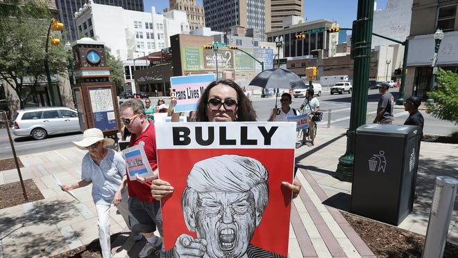 Transgender El Pasoan Chyna Fierro marches into San Jacinto Plaza Saturday with a small group who were protesting President Donald Trump's comments on transgender people in the military.