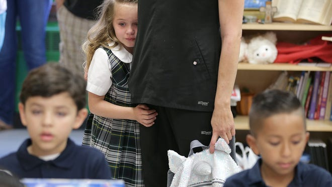 Stephanie Baldwin drops off her daughter Kennedy Baldwin at St. Patrick Cathedral School.