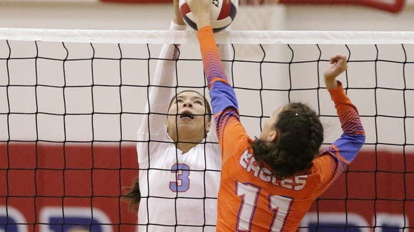 Socorro's Alicia Aguilar blocks Canutillo's Kayla Carrillo during their match Tuesday night at Socorro High School.