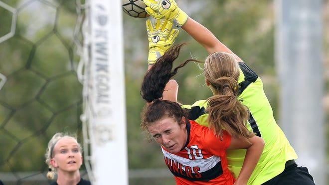 Abilene Christian goalkeeper Erin Smith beats UTEP's Vic Bohdan to a corner kick Sunday during their match at University Park.