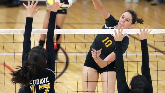 Eastwood hitter Caitlan Buettner tries to hit past