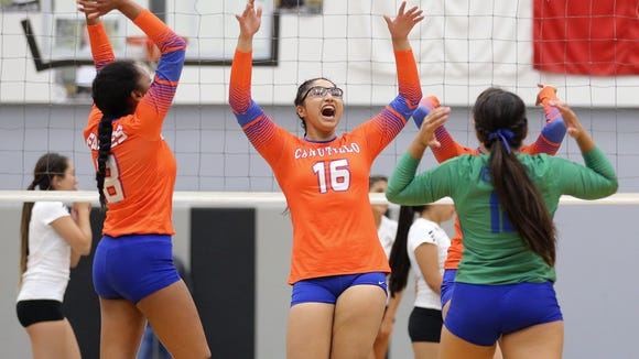 Canutillo celebrates a point over Horizon during their match Tuesday night at Horizon High School.