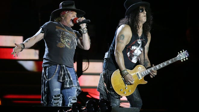 Axl Rose and Slash rock out at the Sun Bowl to a near-sold-out crowd during their Not in This Lifetime Tour. ZZ Top started the night off.