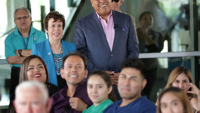 "ABC's ""What Would You Do?"" host John Quiñones watches a humorous tribute to his show made by El Paso Community College students before he spoke about diversity Thursday at the Valle Verde Campus. Quiñones was invited to speak at EPCC as part of the college's Hispanic Heritage Month celebration. Standing next to him is EPCC Vice President Josette Shaughnessy."
