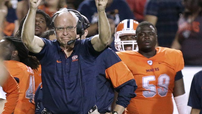 UTEP interim head coach Mike Price cheers on his team on a critical third down stop Saturday against Western Kentucky.