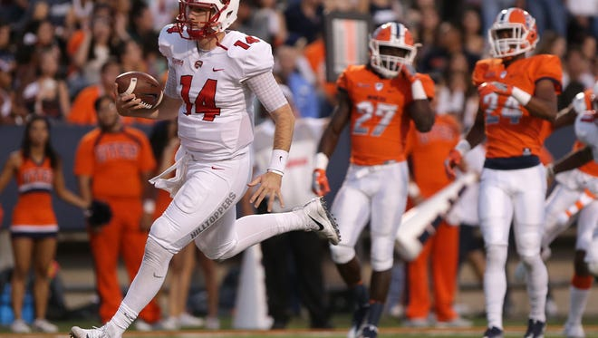 Western Kentucky quarterback Mike White scores untouched on a keeper against UTEP Saturday at the Sun Bowl in El Paso.