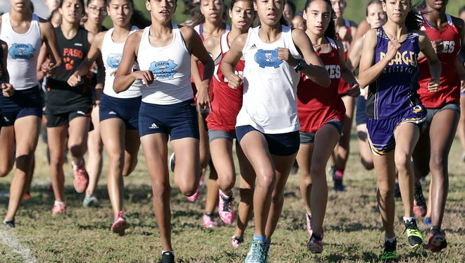 Chapin's Skyler Goodman, center, leads start to finish in the girl's 1-5A Cross Country Championships Thursday at the Chamizal National Memorial. Goodman finished with a time of 20:10.86.