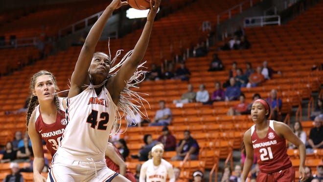 UTEP's Tamara Seda pulls down one of her ten rebounds against Arkansas Friday during the UTEP Thanksgiving Classic at the Don Haskins Center. Seda finished with a double double in the Miners' 64-61 win.
