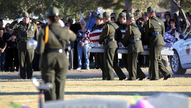 Border Patrol pallbearers carry Border Patrol Agent Rogelio Martinez's coffin during a graveside service Nov. 25 at Restlawn Cemetery. Martinez was on patrol in the Big Bend Sector when he suffered fatal injuries in the line of duty. The FBI is investigating his death.