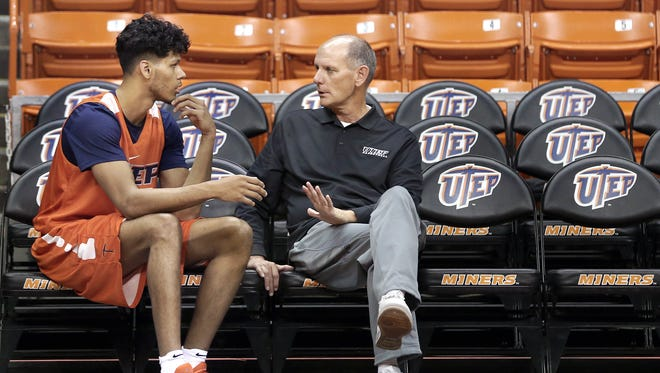 UTEP interim head coach Phil Johnson talks with UTEP junior forward Paul Thomas before Tuesday's practice at the Don Haskins Center after head coach Tim Floyd abruptly retired after Monday's loss to Lamar.